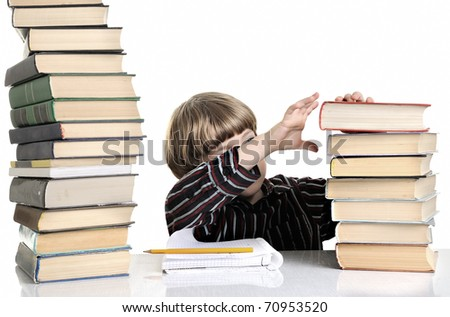 Upset schoolboy doing homework isolated on white