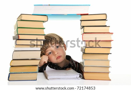 Upset schoolboy doing homework isolated on white. Isolated.