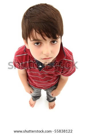 Upset seven year old boy. Casual and barefoot over white. - stock photo