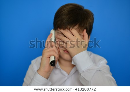Upset teenage boy talking by a radiotelephony - stock photo