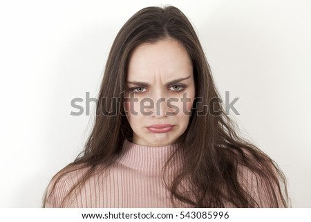 Upset woman, scowling face expression