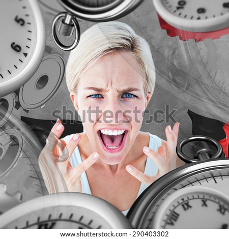 Upset woman yelling with hands up against grey background - stock photo