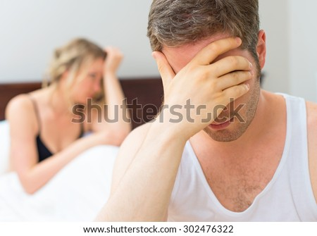 Upset young couple having problems with sex. - stock photo