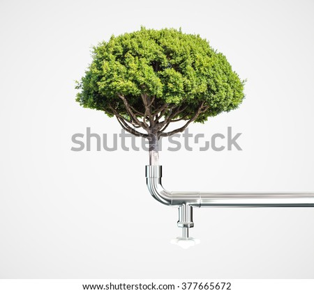 Upside crane with tree, green life concept - stock photo