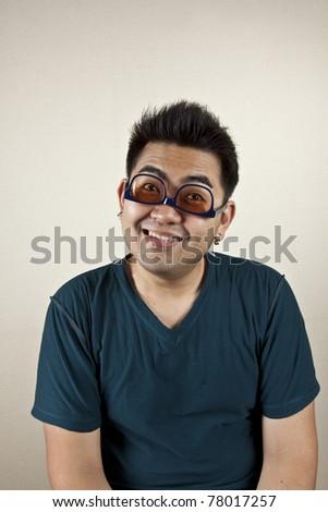 upside down, A man wearing eyeglass upside down, funny face. - stock photo