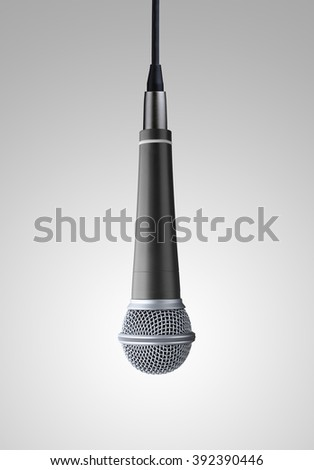 upside down microphone on gray background - stock photo
