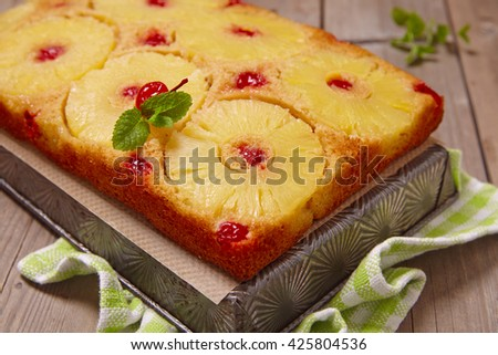 Upside down pineapple cake with mint leaf - stock photo
