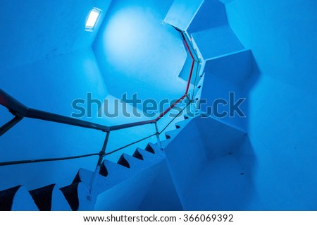 Upside view of a spiral staircase in a lighthouse - stock photo