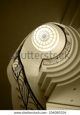 Upside view of an old spiral stairway case - stock photo