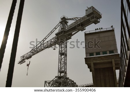 upstream hydropower plants: crane, hydraulic lock, the section of hydraulic barriers, metal construction - stock photo