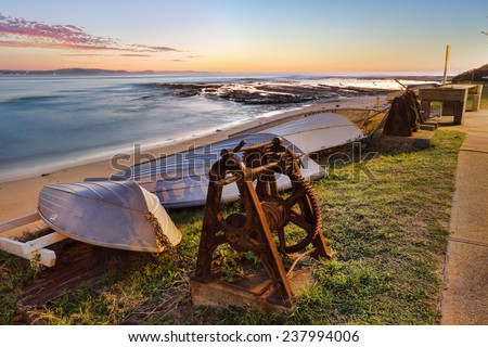 Upturned boats and the view  south from Long Reef on Sydney's northern beaches. - stock photo