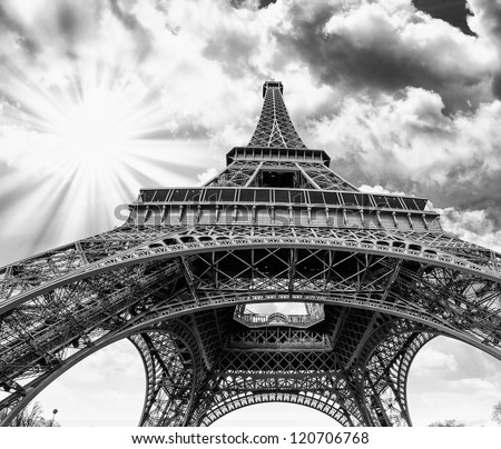 Upward Fisheye view of Eiffel Tower in Paris on a sunny winter morning - France