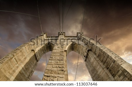 Upward image of Brooklyn Bridge Architectural detail in New York - stock photo