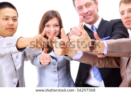 Upward view of hands showing their thumbs - stock photo