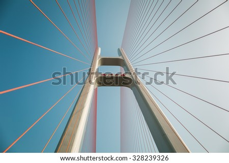 upward view of the cable stayed bridge against blue sky , jiujiang, China