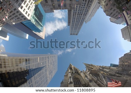 Upward- you look you will see the skyscrapers of Saint Patrick's Cathedral, New York - stock photo