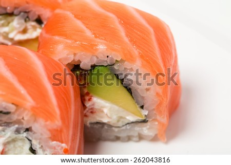 Uramaki salmon roll with scallops. Can be used as a background.