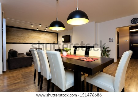 Urban apartment - climatic lightet up interior in modern house - stock photo