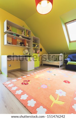 Urban apartment - colorful baby room with wooden crib