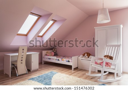 Urban apartment - cute pink girl's room on the attic - stock photo