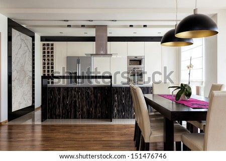 Urban apartment - Kitchen interior with dining table - stock photo