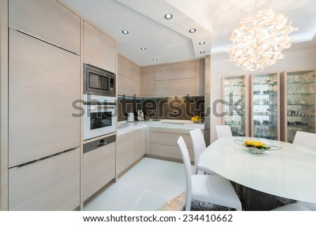 Urban apartment -Kitchen with dining table - stock photo