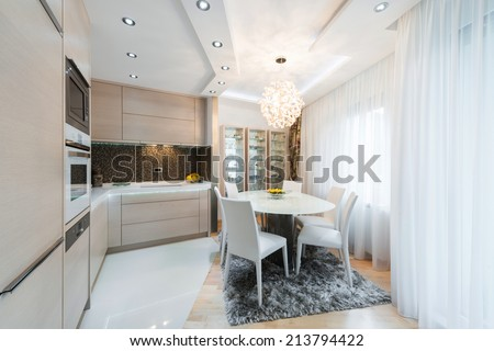 Urban apartment -Kitchen with wooden dining table - stock photo