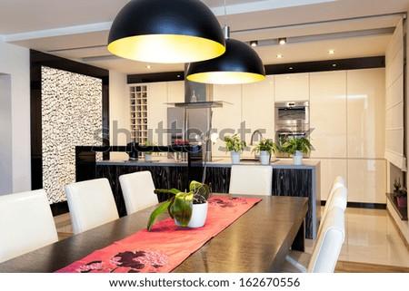 Urban apartment - New kitchen with original stone wall - stock photo