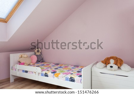 Urban apartment - wooden bed in child's room - stock photo