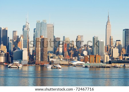 Urban Architecture, New York City over Hudson River with Empire State building. - stock photo