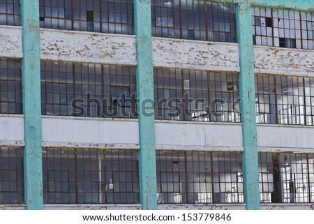 Urban Automotive Blight - Abandoned Automotive Factory - Worn, Broken and Forgotten III - stock photo