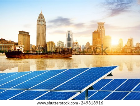 Urban background solar panels, Shanghai, China. - stock photo