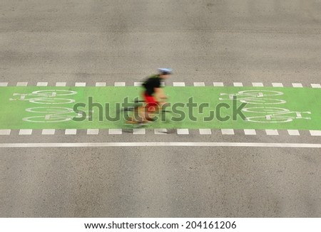 Urban Bicycle Crossing, Vancouver. A cyclist using the designated bicycle lane in downtown Vancouver, British Columbia, Canada. - stock photo
