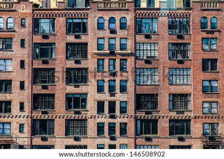 Urban Building Wall Texture Of Brick Building with Windows and Setbacks - stock photo
