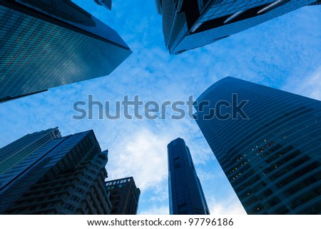 Urban buildings skyscrapers in sky on dusk background - stock photo