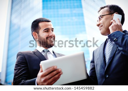 Urban business team being satisfied with the results of their project - stock photo
