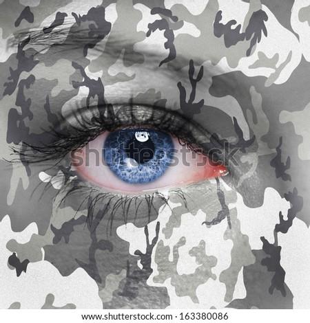 Urban camouflage on human face - stock photo
