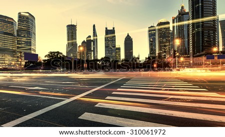 Urban city at night with traffic and night skyline - stock photo