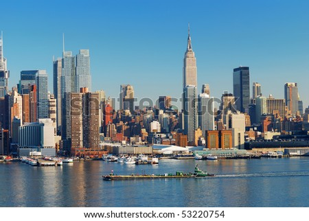 Urban city skyline, Manhattan with Empire State Building, New York City over Hudson River with boat and pier. - stock photo