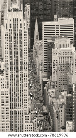 Urban city street aerial view in black and white. New York City Manhattan with skyscrapers, pedestrian and busy traffic. - stock photo