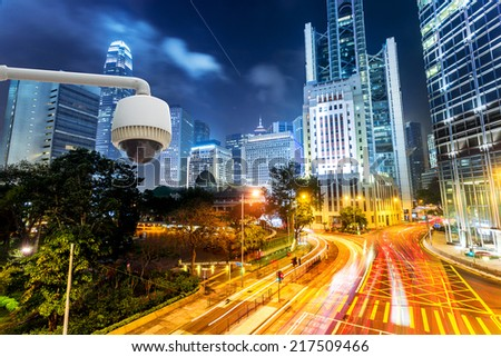urban city street CCTV with traffic light trail background - stock photo