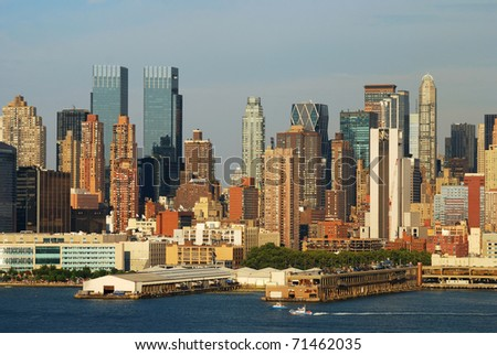 Urban city sunset. New York City Manhattan skyline at sunset with skyscrapers over Hudson river. - stock photo