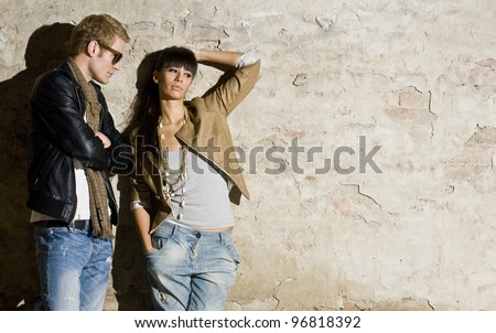Urban couple flirting - stock photo