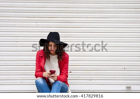 urban fashion girl with phone