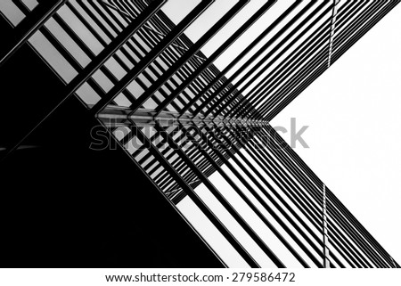 Urban Geometry, looking up to glass building. Modern architecture black and white, glass and steel. X marks the spot. Abstract architectural design. Inspirational, artistic image BW. - stock photo