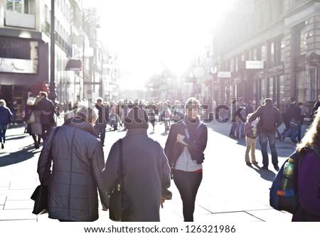 Urban girl striding through city area - stock photo