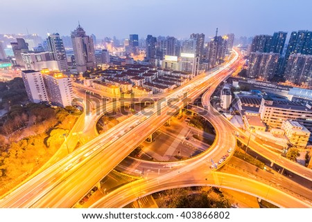 urban grade separation bridge in nightfall , shanghai ,China - stock photo