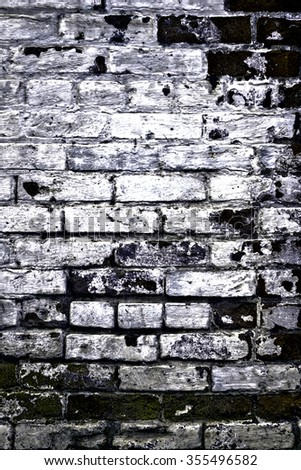 Urban grunge: Detail of whitewashed exterior brick wall, with filtered effects, for texture and background (second in a series of eleven) - stock photo