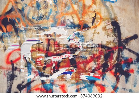 Urban grunge texture, torn posters and graffiti on street wall, paper scrap and spray paint stains