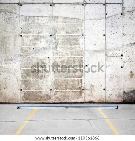 Urban grungy parking wall, may be used as background or texture - stock photo